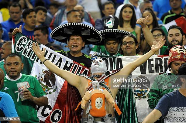 Mexico fans cheer their team ahead of their FIFA World Cup 2018 qualifiers football match against El Salvador in the Cuscatlan Stadium in San...