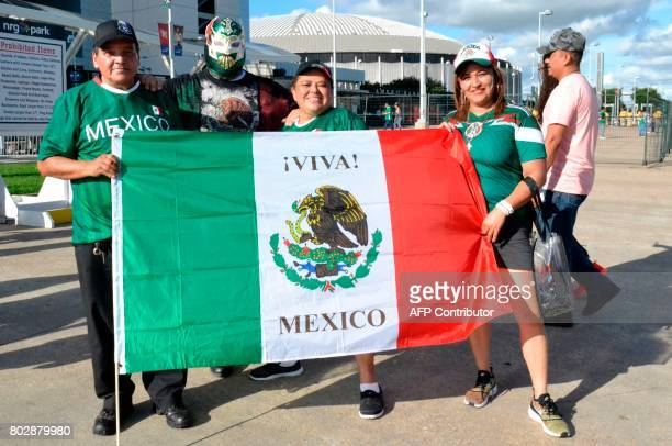 Mexico fans pose with their national flag outside NRG stadium before the start of the friendly match between Mexico and Ghana on June 28 HoustonTexas...