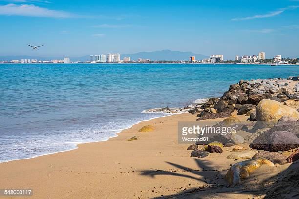 Mexico, Jalisco, Puerto Vallarta, Rocky beach at Malecon boardwalk, View at Hotel Zone and Nuevo Vallarta in the North, Banderas Bay