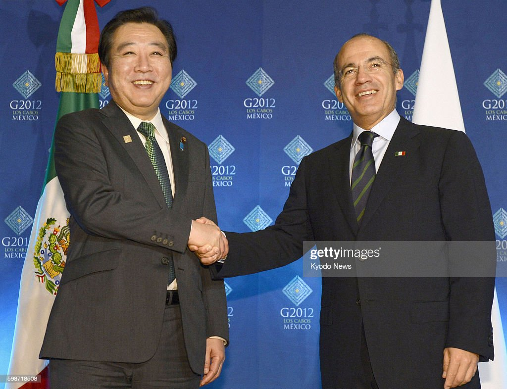 LOS CABOS Mexico Japanese Prime Minister Yoshihiko Noda and Mexican President Felipe Calderon shakes hands ahead of talks in the Mexican resort of...