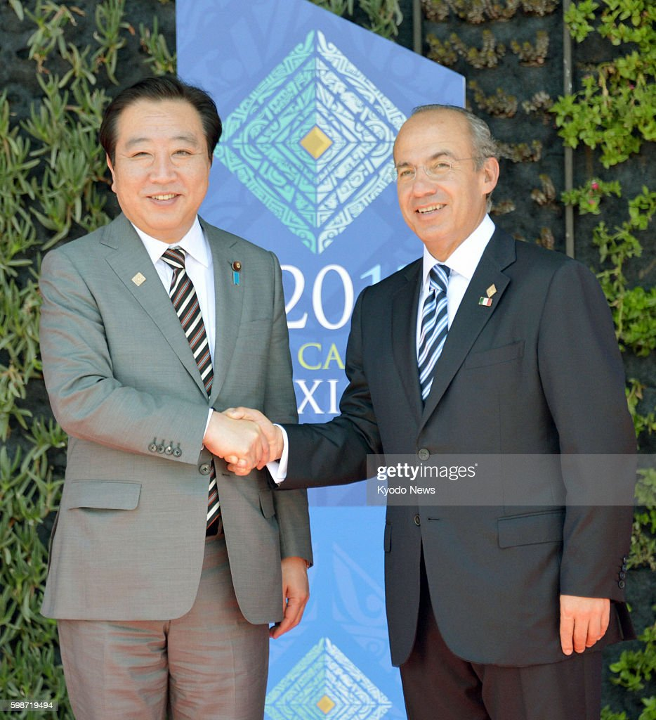 LOS CABOS Mexico Japanese Prime Minister Yoshihiko Noda and Mexican President Felipe Calderon shake hands in Los Cabos Mexico on June 18 ahead of the...