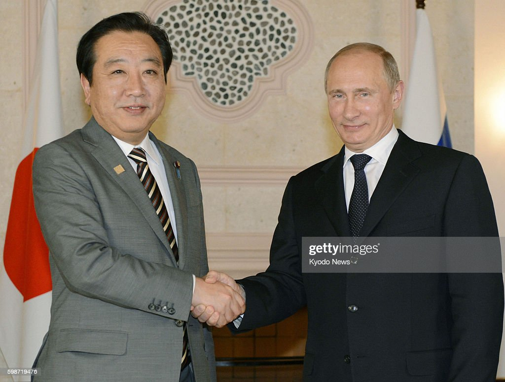 LOS CABOS Mexico Japanese Prime Minister Yoshihiko Noda and Russian President Vladimir Putin shake hands prior to their talks in Los Cabos Mexico on...