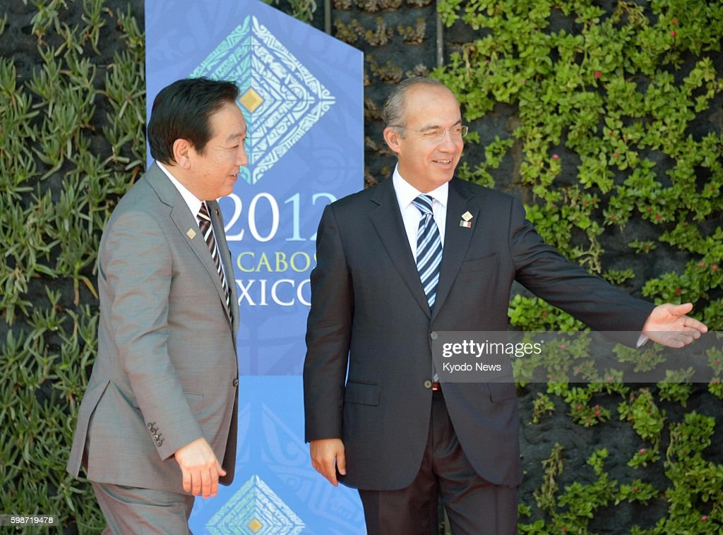 LOS CABOS Mexico Japanese Prime Minister Yoshihiko Noda is greeted by Mexican President Felipe Calderon in Los Cabos Mexico on June 18 ahead of the...