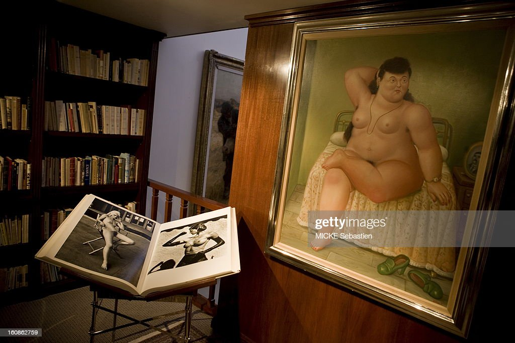 Mexico - May 22, 2010 --- Juan Antonio Perez Simon, Mexican billionaire, has built in thirty years a collection of masterpieces covering five centuries of art history. Here in a corner of his office, a painting by Fernando Botero, 'Woman sitting on a bed.' .