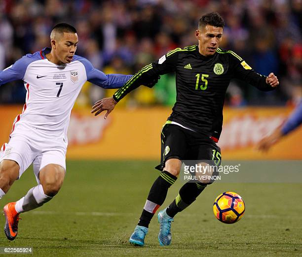 Mexico men's national team defender Hector Moreno works for the ball against US men's national team forward Bobby Wood during the 2018 FIFA World Cup...