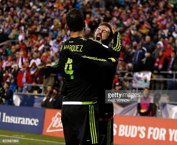 Mexico men's national team defender Miguel Layun celebrates with teammate defender Rafael Marquez after Marquez's goal against the US men's national...