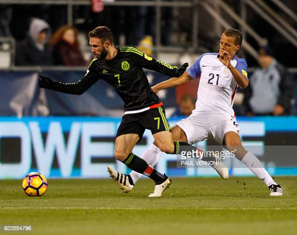 Mexico men's National team defender Miguel Layun works against US men's National defender Timmy Chandler during the 2018 FIFA World Cup qualifying...