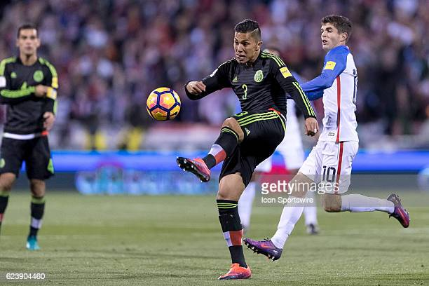 Mexico Men's National Team player Carlos Salcedo battles with United States Men's National Team player Christian Pulisic to clear a ball in the first...