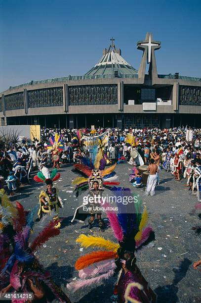 Mexico Mexico City Our Lady of Guadaloupe Festival dancers celebrating outside the Basilica of Guadaloupe