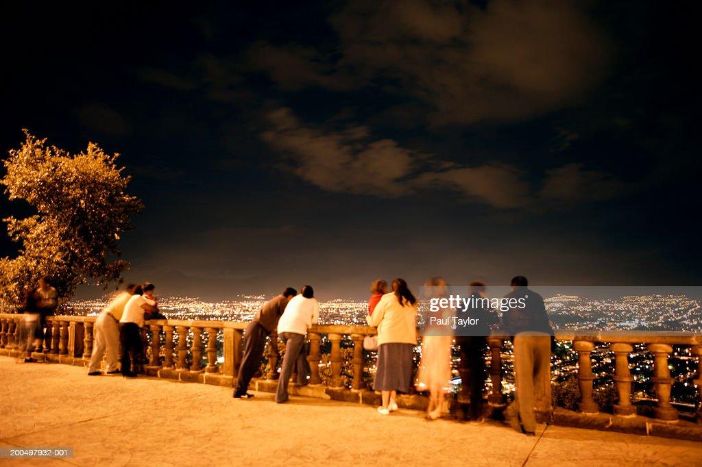 Mexico, Michoacan, Morelia, people looking at city lights at night : Stock Photo