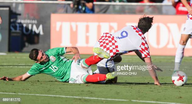 Mexico midfielder Hector Herrera left crashes with Croatia forward Ivan Santini during the second half of an international friendly soccer game at LA...