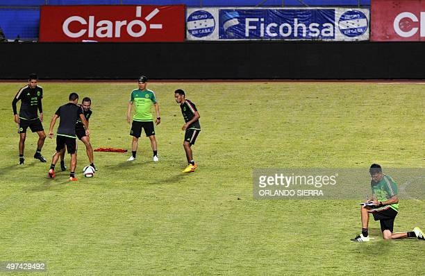 Mexico national football team coach Juan Carlos Osorio takes notes during a field recognition at the Olimpico Metropolitano stadium in San Pedro Sula...