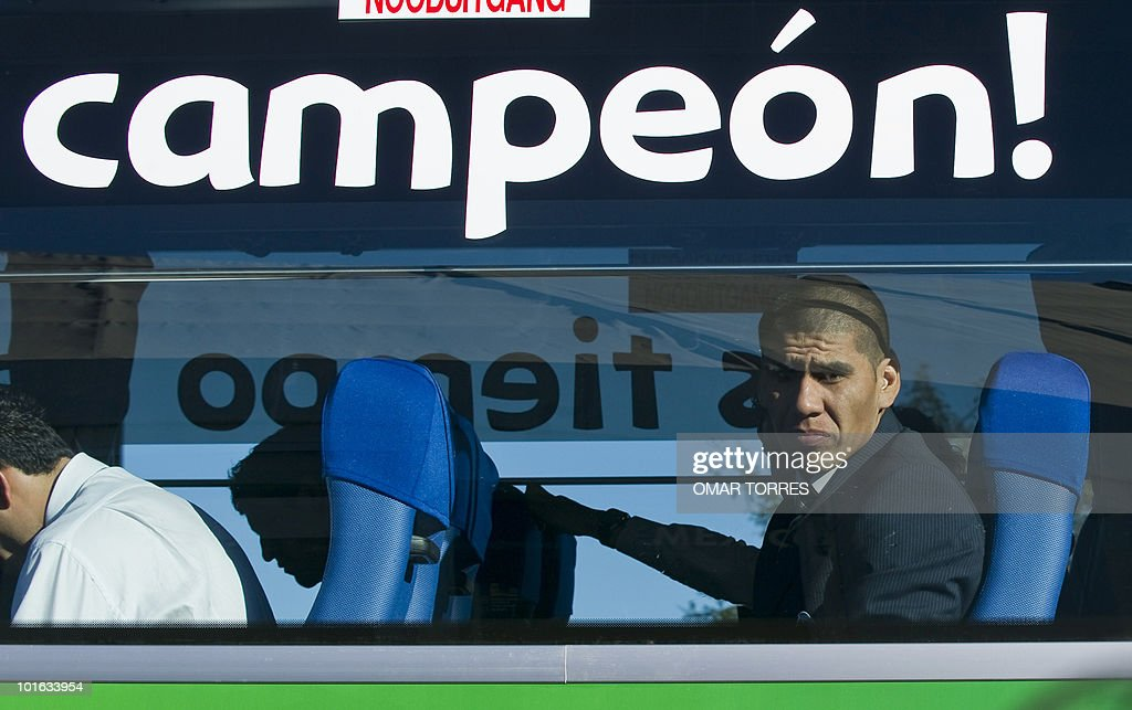 Mexico national football team defender Carlos Salcido waits in the bus upon arrival with his team at the O.R Tambo airport in Johannesburg on June 5, 2010.Mexico will play their first 2010 World Cup game on June 11. Sticker on bus reads: 'Champion!'