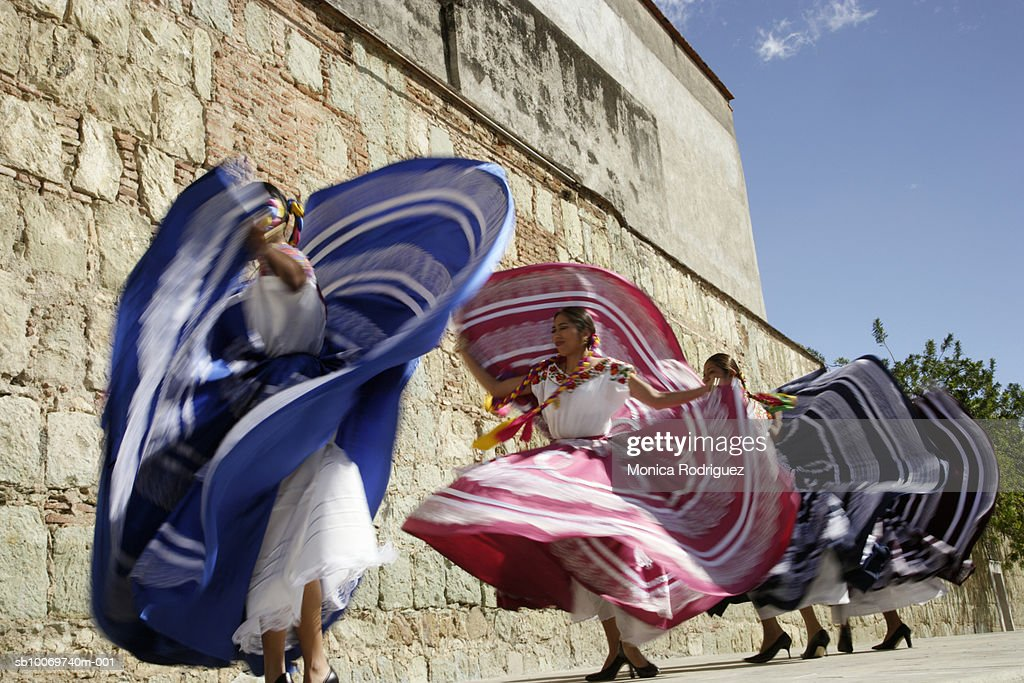 Mexico, Oaxaca, Istmo, four women in traditional dress dancing, blurred motion : Stock Photo