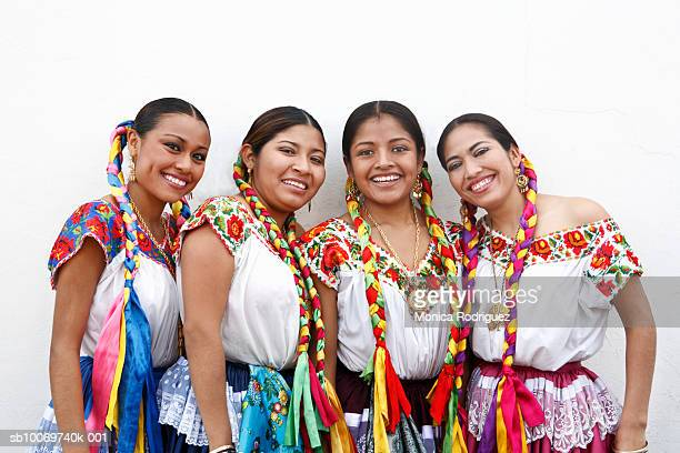 Mexico, Oaxaca, Istmo, group portrait of women in traditional clothing, outdoors
