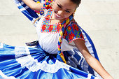 Mexico, Oaxaca, Istmo, woman in traditional dress dancing