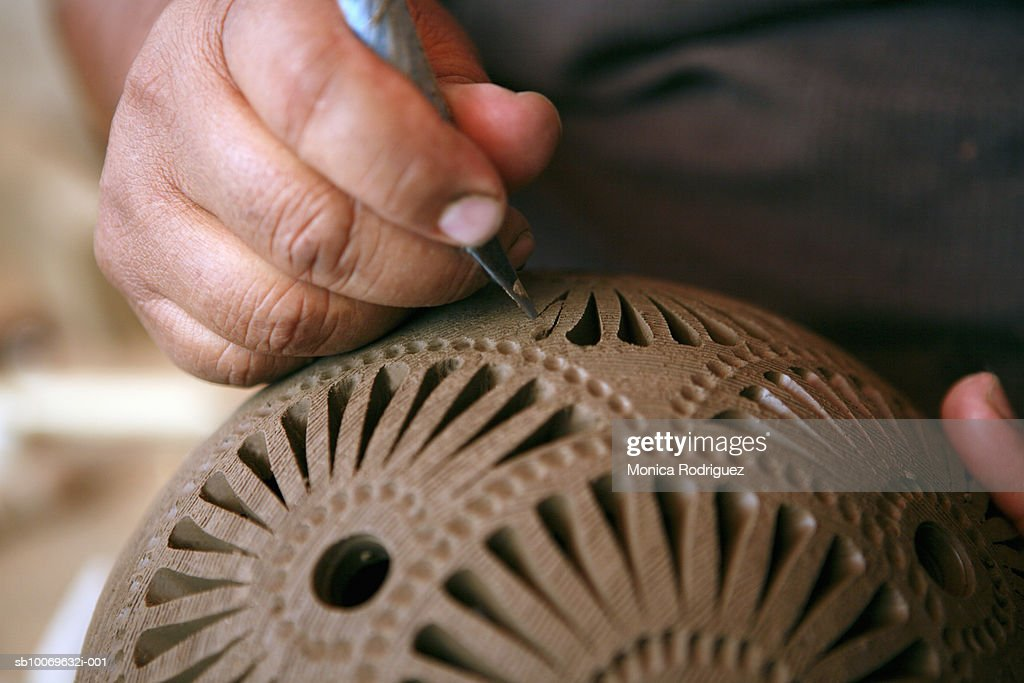 Mexico, Oaxaca, man making black ceramic decorative pottery, close-up of hands : Stock Photo