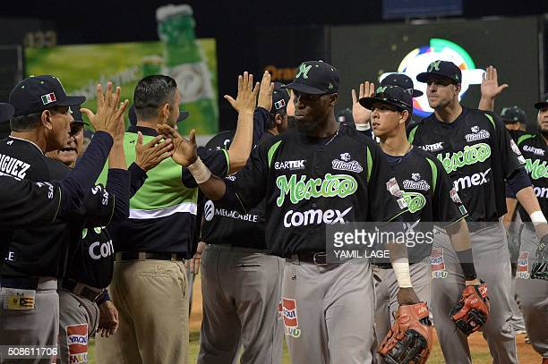 Mexico players celebrate after defeating Puerto Rico in their 2016 Caribbean baseball series game on February 5 2016 in Santo Domingo AFP PHOTO/YAMIL...