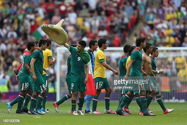Mexico players celebrate after winning gold in the Men's Football Final between Brazil and Mexico on Day 15 of the London 2012 Olympic Games at...