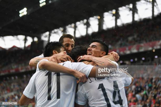 Mexico players celebrate as Luis Neto of Portugal scored a own goal for Mexico's first goal during the FIFA Confederations Cup Russia 2017 PlayOff...