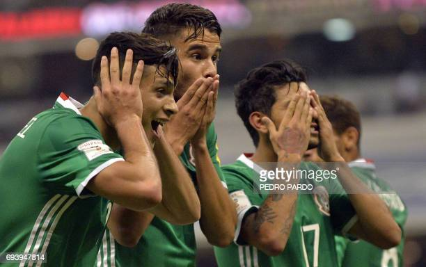 TOPSHOT Mexico players celebrate their victory over Honduras during their World Cup 2018 CONCACAF qualifiers football match in Mexico City on June 8...