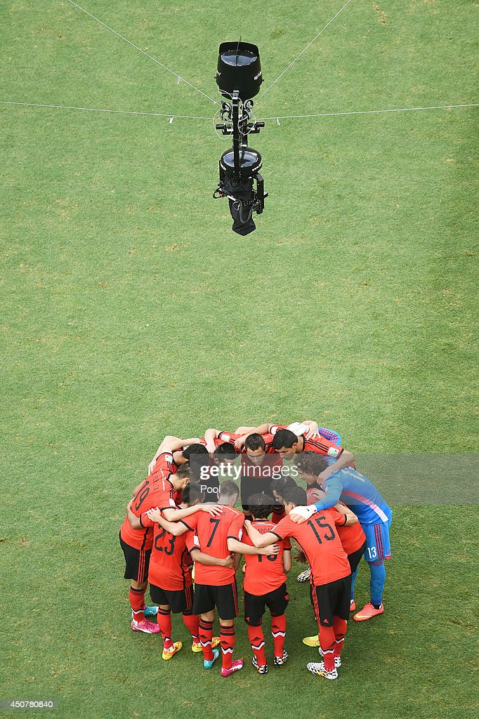 Mexico players huddle during the 2014 FIFA World Cup Brazil Group A match between Brazil and Mexico at Castelao on June 17, 2014 in Fortaleza, Brazil.