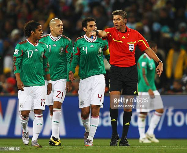 Mexico players protest Argentina's opening goal as Referee Roberto Rosetti gestures during the 2010 FIFA World Cup South Africa Round of Sixteen...