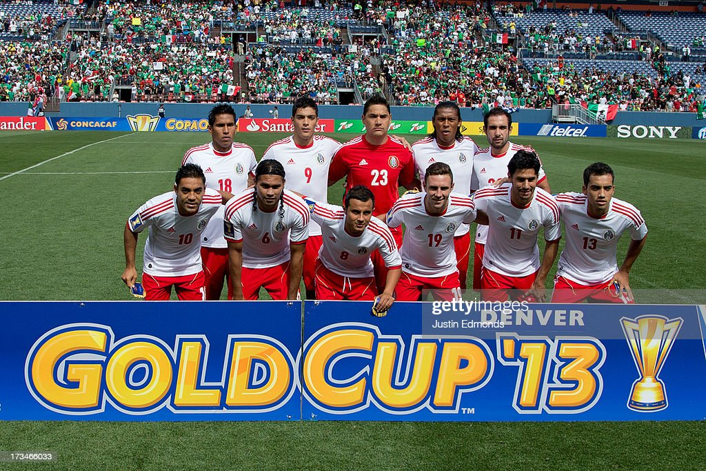 Mexico poses on the pitch before a match against Martinique in the CONCACAF Gold Cup at Sports Authority Field at Mile High on July 14, 2013 in Denver, Colorado.