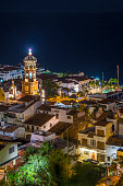 Mexico, Puerto Vallarta, at night, downtown with church tower