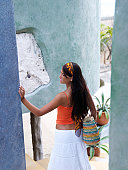 Mexico, Quintana Roo, Tulum, Young woman with straw bag at resort