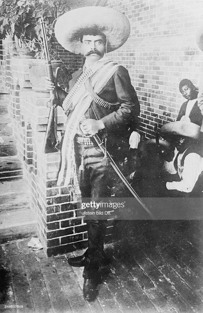 Mexico Revolution 1911-29 <a gi-track='captionPersonalityLinkClicked' href=/galleries/search?phrase=Emiliano+Zapata&family=editorial&specificpeople=743817 ng-click='$event.stopPropagation()'>Emiliano Zapata</a> Salazar *08.08.1879-+ Revolutionary, Mexico Portrait with sombrero, gun, and rapier during the Mexican revolution - May 1914