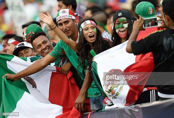Mexico soccer fans cheer before the 2015 CONCACAF Gold Cup final between Jamaica and Mexico in Philadelphia on July 26 2015 AFP PHOTO/DON EMMERT