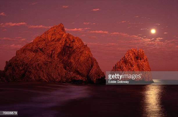 Mexico, South Baja, rock formations off coast, moonrise, sunset