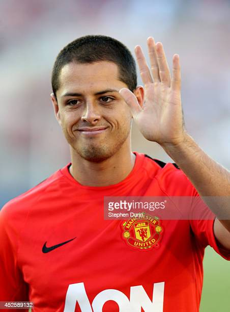 Mexico star Javier 'Chicharito' Hernandez of Manchester United waves to fans as he trains before the game with the Los Angeles Galaxy at the Rose...