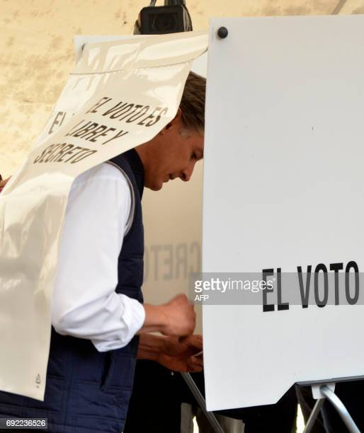 Mexico State candidate for governor for the Institutional Revolutionary Party Alfredo del Mazo votes at a polling station in Huixquilucan Mexico...