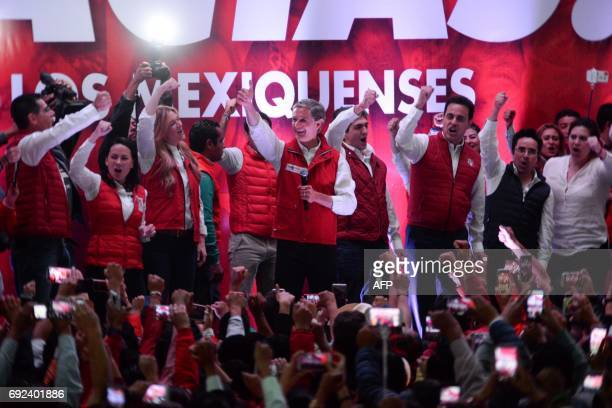 Mexico state gubernatorial candidate for the Institutional Revolutionary Party Alfredo Del Mazo and other party members greet supporters at the...