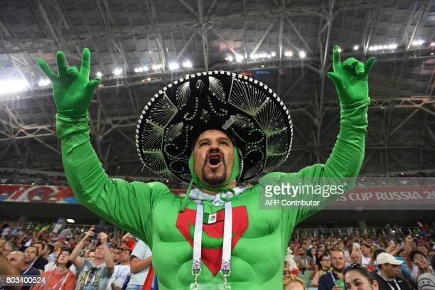 A Mexico supporter cheers for his team before the 2017 FIFA Confederations Cup semifinal football match between Germany and Mexico at the Fisht...