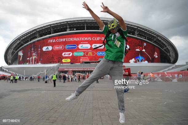 Mexico supporter jumps outside the Kazan Arena ahead of the 2017 Confederations Cup group A football match between Portugal and Mexico in Kazan on...