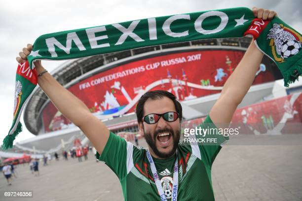 Mexico supporter poses outside the Kazan Arena ahead of the 2017 Confederations Cup group A football match between Portugal and Mexico in Kazan on...