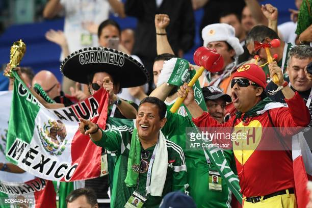 TOPSHOT Mexico supporters cheer during the 2017 FIFA Confederations Cup semifinal football match between Germany and Mexico at the Fisht Stadium in...