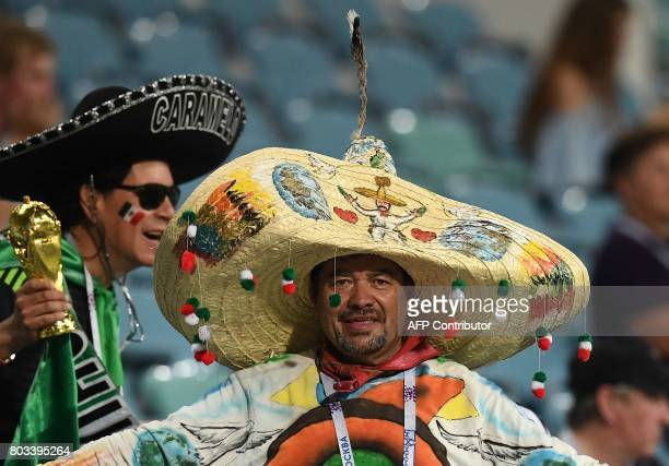 TOPSHOT Mexico supporters cheer for their team before the 2017 FIFA Confederations Cup semifinal football match between Germany and Mexico at the...