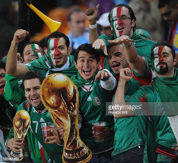 Mexico supporters with cutout replicas of the World Cup trophy cheer before the 2010 World Cup round of 16 football match Mexico versus Argentina on...
