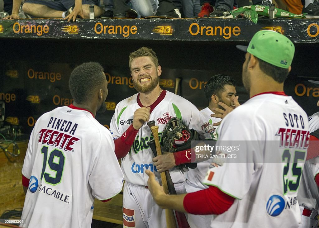 Mexico team members celebrate after winning the final game against Venezuela in the 2016 Caribbean baseball series in Santo Domingo, Dominican Republic, on February 7, 2016. AFP PHOTO/ERIKA SANTELICES / AFP / ERIKA SANTELICES
