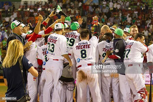 Mexico teammates celebrate after defeating Venezuela in the final game of the 2016 Caribbean baseball series in Santo Domingo Dominican Republic on...