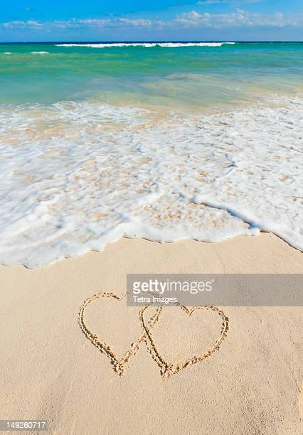 Mexico, Yucatan, Heart drawing in sand on beach