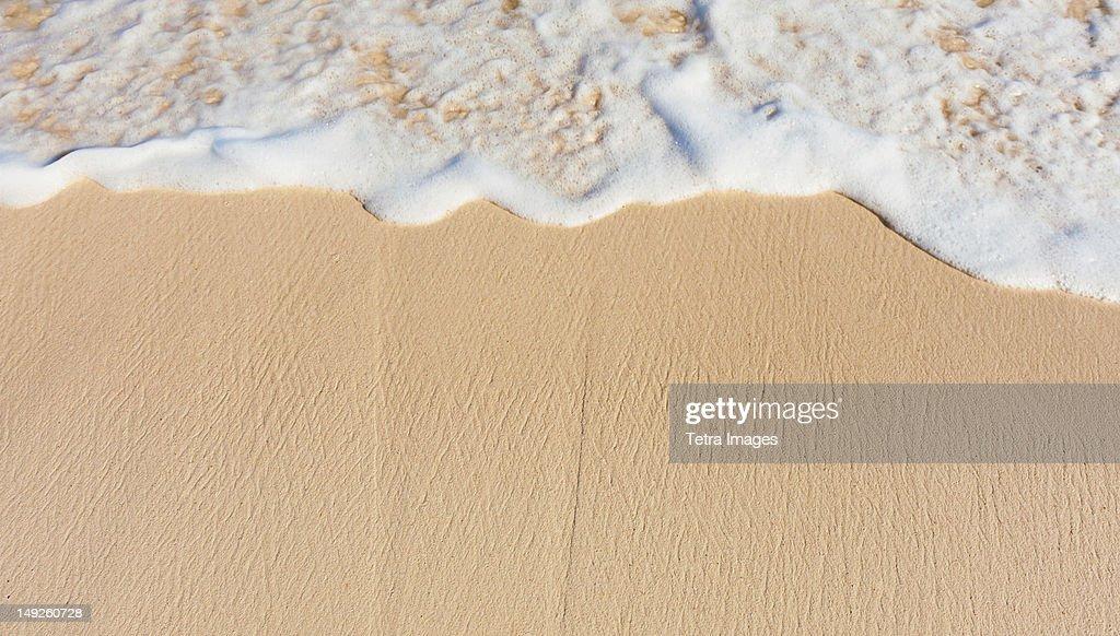 Mexico, Yucatan, Sea waves on beach sand