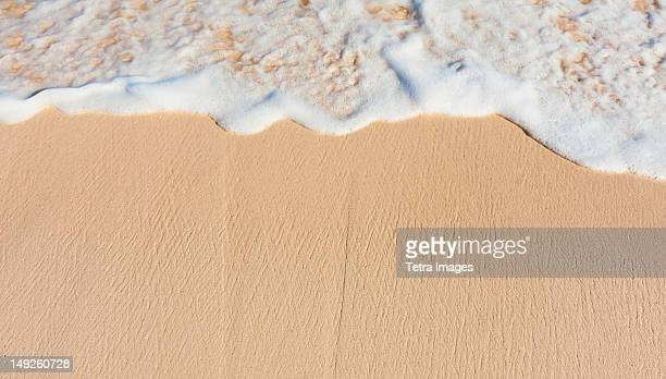 Mexico, Yucatan, Sea waves on beach sand