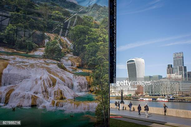 Mexico's Agua Azul Waterfalls appears on a large ad for Mexican tourism with the City of London architecture on the northern side of the River Thames...