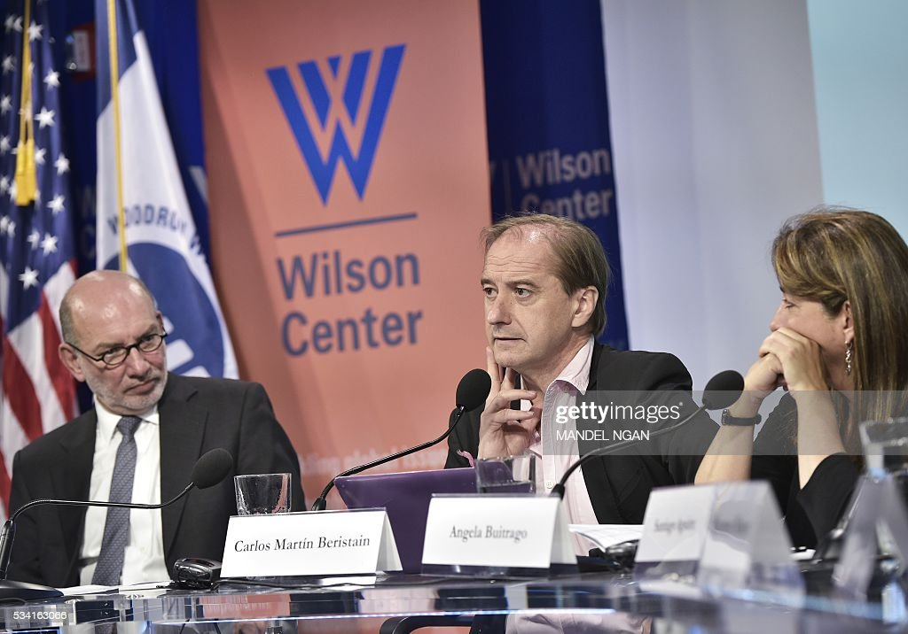 Mexico's Ambassador to Austria Luis Alfonso de Alba (L) and Angela Buitrago (R) of Colombia, watch as expert Carlos Martín Beristain (C) of Spain speaks on the report by the Interdisciplinary Group of Independent Experts on the disappearance of 43 students from the Rural Teachers College in Ayotzinapa, Mexico at the Wilson Center's Mexico Institute on May 25, 2016 in Washington, DC. / AFP / MANDEL
