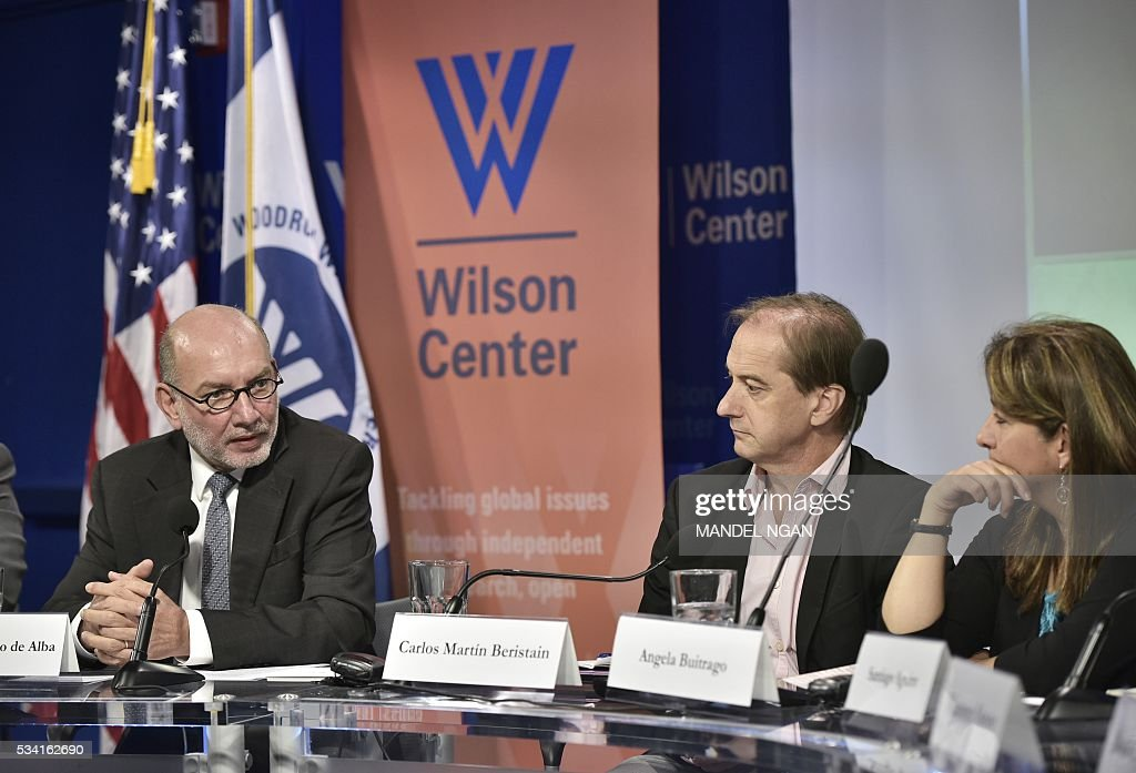 Mexico's Ambassador to Austria Luis Alfonso de Alba (L) speaks, watched by experts Carlos Martín Beristain (C) of Spain and Angela Buitrago (R) of Colombia,on the report by the Interdisciplinary Group of Independent Experts on the disappearance of 43 students from the Rural Teachers College in Ayotzinapa, Mexico at the Wilson Center's Mexico Institute on May 25, 2016 in Washington, DC. / AFP / MANDEL
